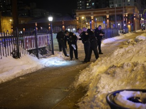 Police look for evidence after gunshots were heard near Loyola. Photo By Ralph Braseth