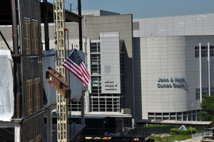 A crane places the last beam atop Loyola's new medical research center. Loyola University Chicago photo.