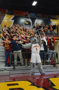 Loyola mascot LU Wolf leads fans in a cheer at Midnight Madness. Photo from Loyola Ramblers Facebook page.