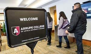 Students register for Arrupe Colege. Photo courtesy JesuitMidwest.org